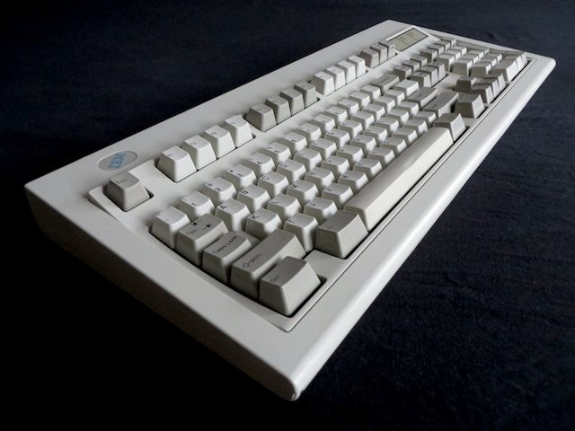 'Stole' this picture from Arstechnica Why I use a 20-year-old IBM Model M keyboard. When ever I encounter one myself, I'll take my own pic!